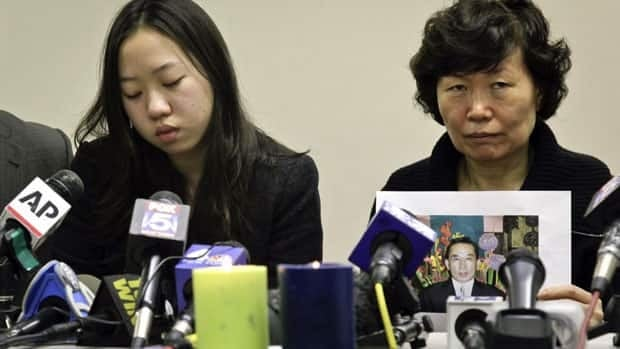 Serim Han, right, the wife of subway victim Ki-Suck Han, and her daughter, Ashley Han, spoke at a news conference Wednesday in New York City.