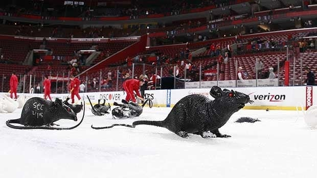 Arena staff work to clear rats from the ice surface following Florida's Game 2 win over New Jersey last week.