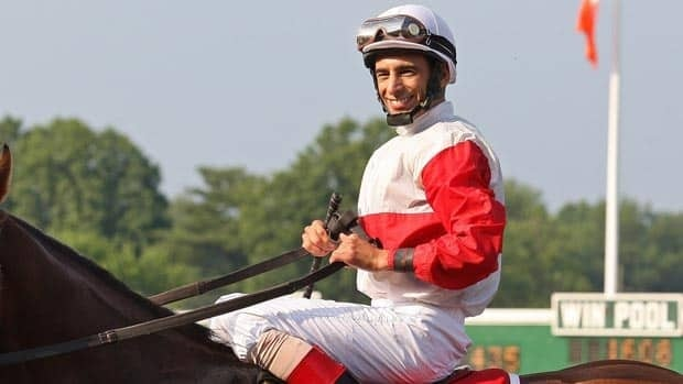 John Velazquez, seen celebrating a win in Monmouth, N.J. the day after the Belmont Stakes, is scheduled to be inducted in the sport's hall of fame. Bill Denver/Associated Press