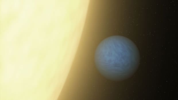 An artist's conception of the super-Earth 55 Cancri e and the star it orbits every 18 hours. NASA's Spitzer Space Telescope was able to detect a super Earth's direct light for the first time using its sensitive heat-seeking infrared vision.