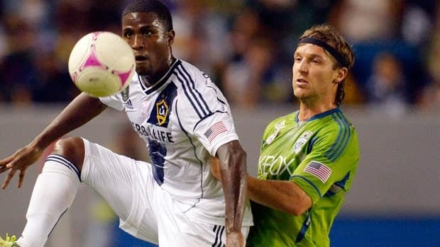 Los Angeles Galaxy forward Edson Buddle, left, and Seattle Sounders FC defender Jeff Parke battle for the ball during the first half action Sunday in Carson, Calif.