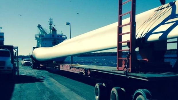 A wind turbine blade more than 50 metres long sits on a truck after being unloaded from a ship in Georgetown, P.E.I.