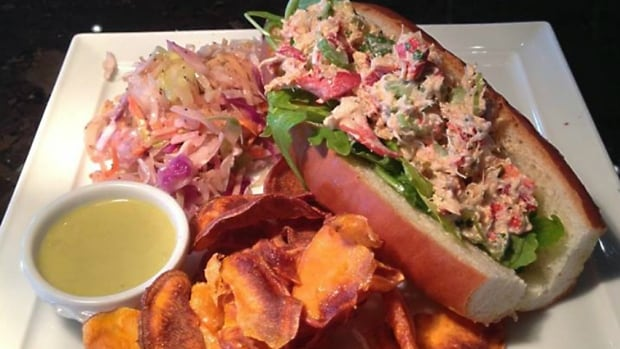 John Gilchrist says the chef at Vagabond knows what he's doing, like with this feature of a lobster roll with sweet potato chips and coleslaw.