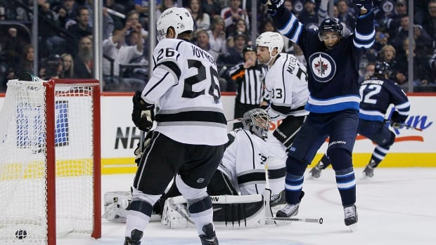 The Winnipeg Jets' Evander Kane and Olli Jokinen celebrate Jokinen's goal against the Los Angeles Kings during the second period Friday night at the MTS Centre.