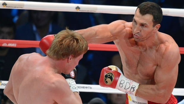 Wladimir Klitschko, right, punches Alexander Povetkin in Moscow on October 5, 2013.
