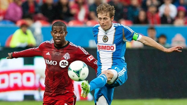 Toronto FC's Jeremy Hall, left, and Philadelphia Union's Brian Carroll in Toronto Saturday June 1, 2013.