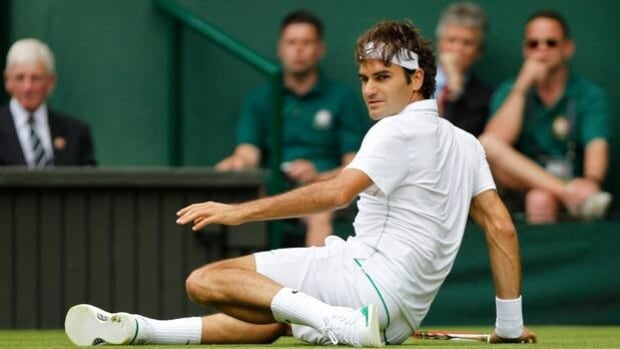 Roger Federer makes a rare slip in Wednesday's victory over Fabio Fognini at Wimbledon.
