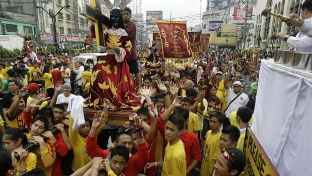 Replicas of a centuries-old black statue of Jesus Christ, known as the Black Nazarene, are blessed during a procession of the replicas in Manila, Philippines.