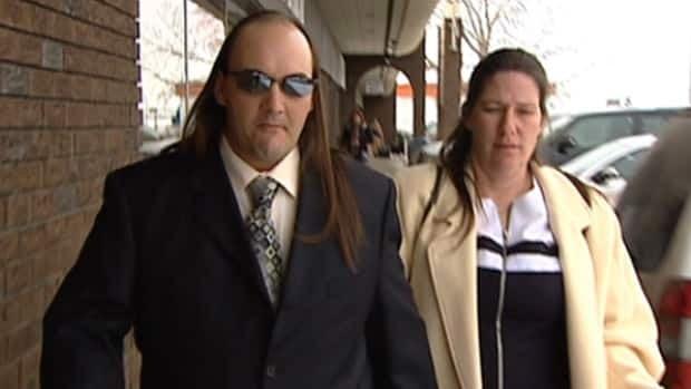 Michael and Denise Scrivens leave the courthouse in Sherwood Park on Monday.