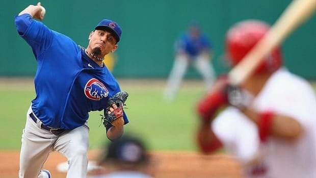 Cubs' starter Matt Garza was taken out after working three scoreless innings against the Cardinals on Saturday night with cramping in his right triceps.
