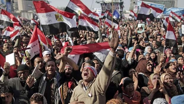 Thousands of Egyptians streamed into Cairo's Tahrir Square, including liberal and secular groups along with members of the Muslim Brotherhood, while the country's security forces stayed out of the area.