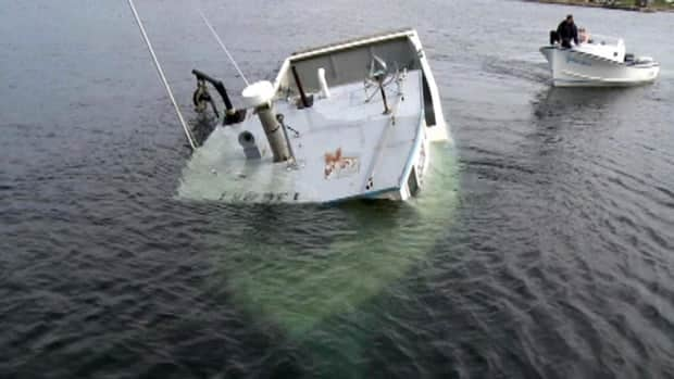 The Emma Lucy was nearly submerged by the time it was towed into St. Lawrence on Wednesday.