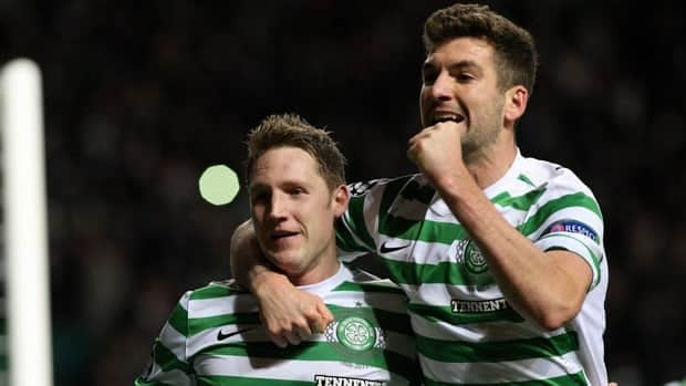 Kris Commons, left, celebrates his goal with Charlie Mulgrew at Celtic Park, Glasgow, Scotland on Wednesday.