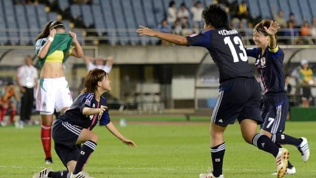 Japanese players celebrate after a goal against Mexico at Miyagi Stadium in Sendai, Japan on Sunday, Aug. 19, 2012.