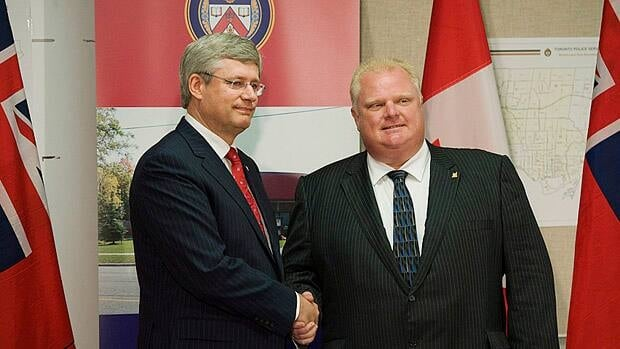 Prime Minister Stephen Harper and Toronto Mayor Rob Ford, seen here after meeting to discuss the shootings in Toronto last July, have a close personal relationship. Last summer, the mayor joined Harper on a fishing trip at the prime minister's retreat at Harrington Lake.