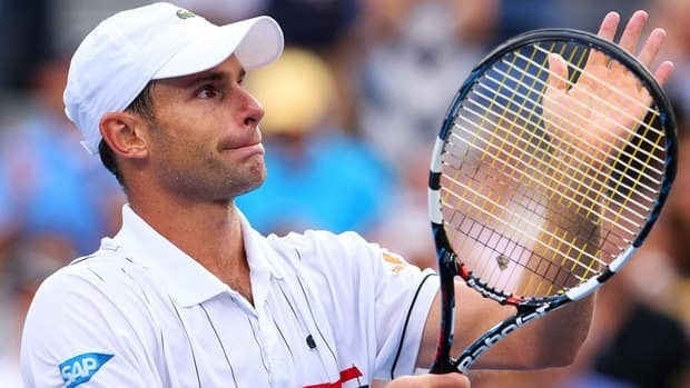 Andy Roddick of the United States waves to the crowd after losing to Juan Martin Del Potro of Argentina, which was the last match of his professional career.