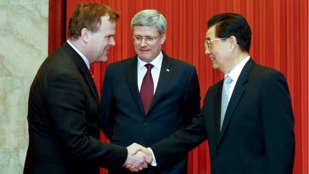 Prime Minister Stephen Harper, flanked here by Foreign Affairs Minister John Baird, left, and Chinese President Hu Jintao, right, has put a greater emphasis on trade with China.
