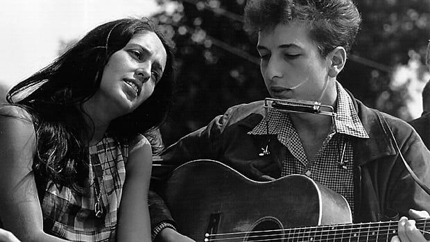 Folk singers Joan Baez and Bob Dylan perform at a Washington D.C. civil rights rally in 1963. The historic electric then-folk star Dylan played at the 1965 Newport Folk Festival is at the heart of a dispute.