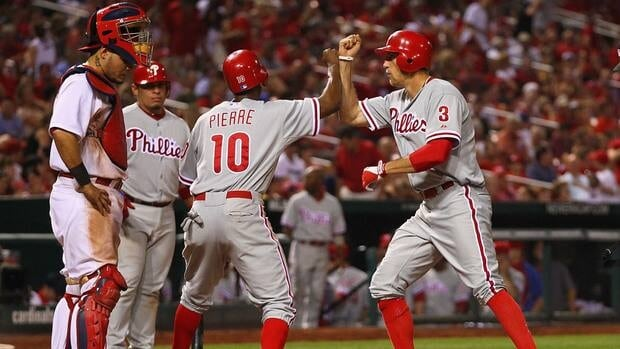 Hunter Pence, right, of the Philadelphia Phillies is congratulated by teammate Juan Pierre after Pence hit the game-winning home run in the tenth inning Friday.