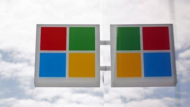 The new Microsoft's recently revamped logo is reflected in windows at a company store in Seattle in August. The software giant says it will have a fix for its browser security problem on Friday.