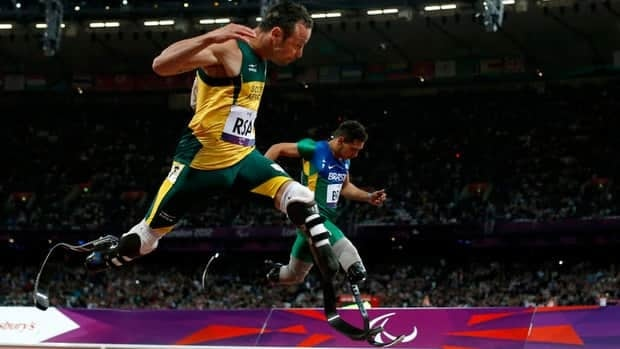 Gold medallist South Africa's Oscar Pistorius, left, sets a new world record of 41.78 seconds as he crosses the line ahead of Brazil's Alan Fonteles Cardoso Oliveira in the men's 4x100m relay T44 category final on Wednesday.