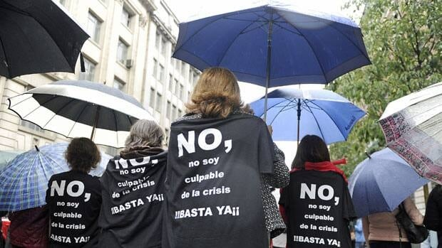 Government employees with t-shirts that read 'No, I am not guilty of the crisis, stop' protest Friday against the Spanish government's latest austerity measures.