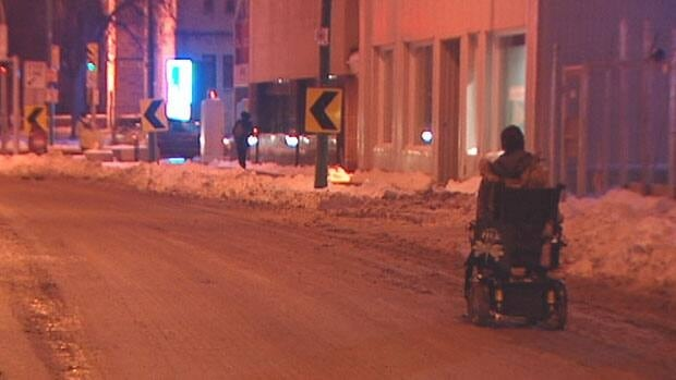 Jesse Turner often has to use the street to get around because the sidewalks still haven't been plowed.