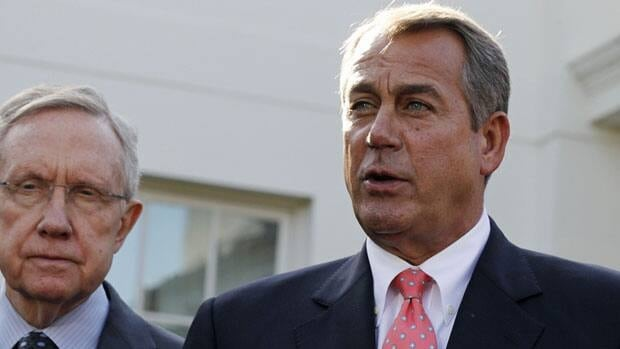 Speaker of the House John Boehner speaks next to Senate Majority Leader Harry Reid, left, after congressional leaders met with U.S. President Barack Obama at the White House Friday.