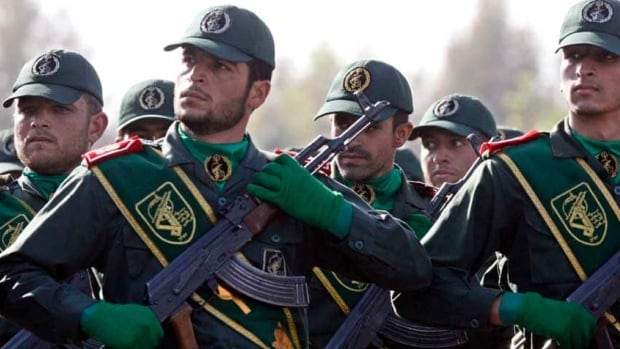 Members of Iran's elite Revolutionary Guard march during a parade in 2008. Iran's presence in Syria is stoking fears that the conflict there could morph into a proxy war.