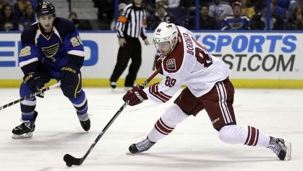 Phoenix Coyotes' Mikkel Boedker, right, shoots and scores in front of St. Louis Blues' Kevin Shattenkirk during the third period Friday.