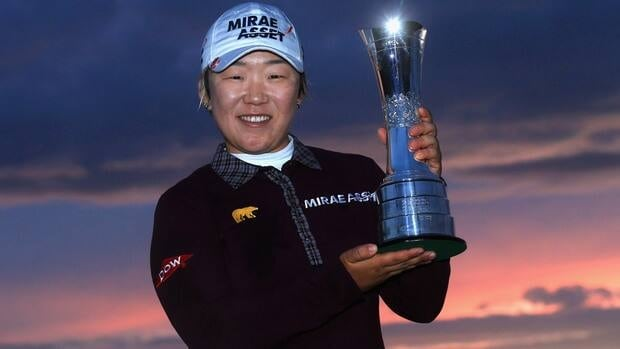 Jiyai Shin of Korea poses with the trophy following her victory during the final round of the Women's British Open at Royal Liverpool Golf Club Sunday in Hoylake, England.