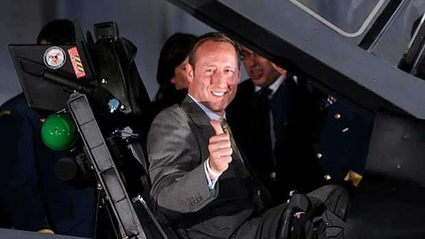 Defence Minister Peter MacKay sits in a fake F-35 fighter jet supplied by Lockheed Martin, at the announcement of planes to replace Canada's aging CF-18 fleet. Cabinet colleagues Tony Clement and Rona Ambrose also posed with the plane at the July, 2010 announcement.