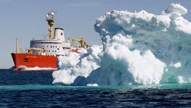 The Canadian Coast Guard icebreaker Louis S. St-Laurent sails past an iceberg in Lancaster Sound on July 11, 2008.
