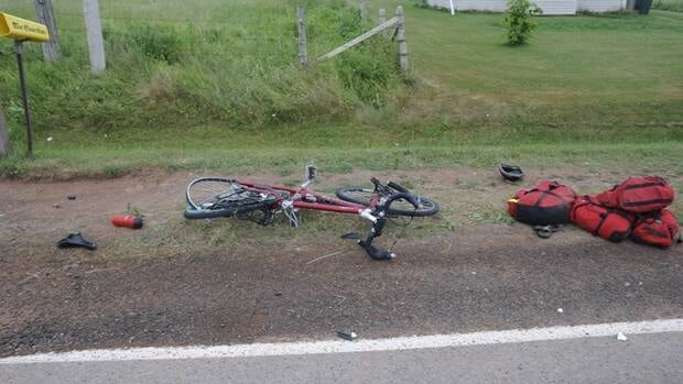 A cyclist from Alberta died Saturday after being struck by a van.