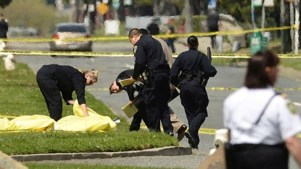 Oakland police cover bodies near Oikos University after a suspect, since detained, opened fire.
