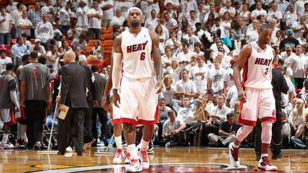LeBron James (6) and Dwyane Wade (3) of the Miami Heat walk off the court in Game 5 against the Boston Celtics in Miami.