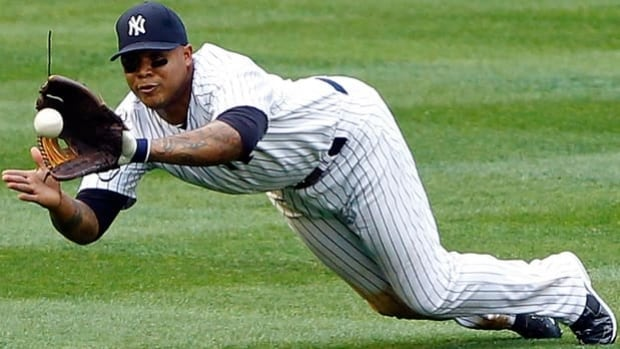 Andruw Jones, seen playing for the Yankees, is a 10-time Gold Glover for fielding excellence.