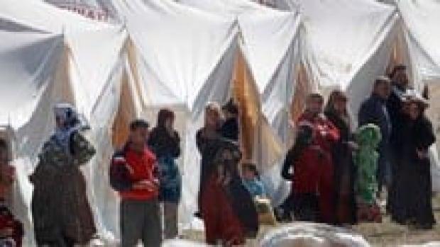 hi-syria-refugees-852-rtr2nm3b-3col