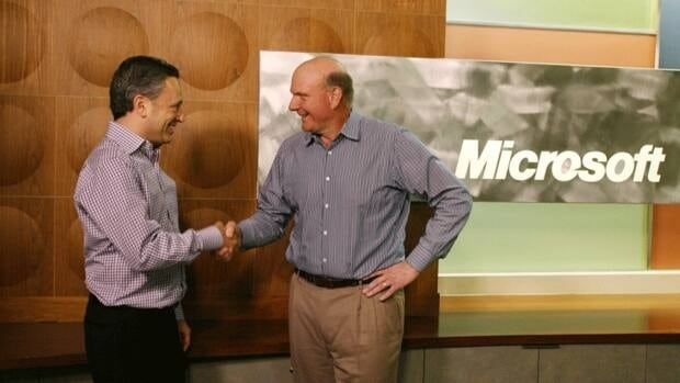 Yammer CEO David Sacks, left, and Microsoft CEO Steve Ballmer shake hands after they announced Microsfot's acquisition of the private networking software in San Francisco on June 25. Yammer has built a social network similar to Facebook for the business world with about five million users.