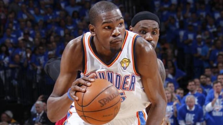 96403602a5f Kevin Durant (35) of the Thunder dribbles up court in Game 1 of the NBA  finals on Tuesday. (Layne Murdoch Getty Images)