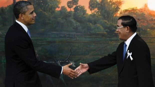 U.S. President Barack Obama, left, is greeted by Cambodia's Prime Minister Hun Sen before the ASEAN-U.S. leaders meeting in Phnom Penh, Cambodia, Monday.