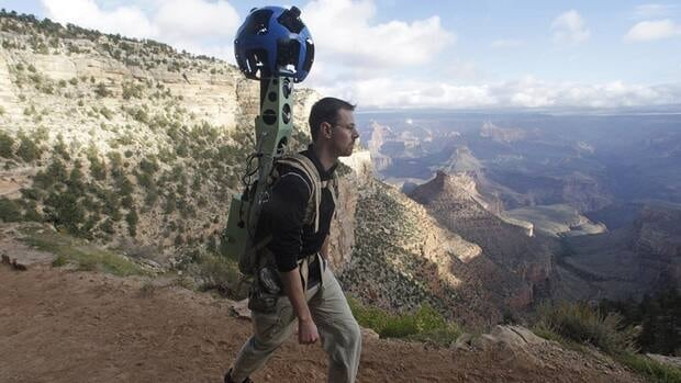 Google product manager Ryan Falor walks with the Trekker during a demonstration Monday for the media along the Bright Angel Trail at the South Rim of the Grand Canyon National Park in Arizona.