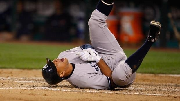 New York Yankees third baseman Alex Rodriguez rolls on the ground after being hit by a pitch in the eighth inning.