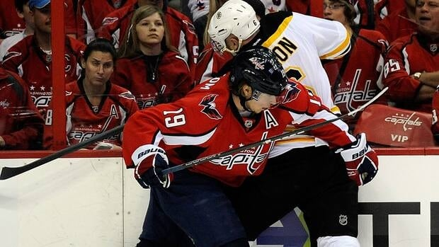 Capitals centre Nicklas Backstrom, front, will miss Game 4 against the Boston Bruins because of his cross-check on Boston forward Rich Peverley, not pictured.