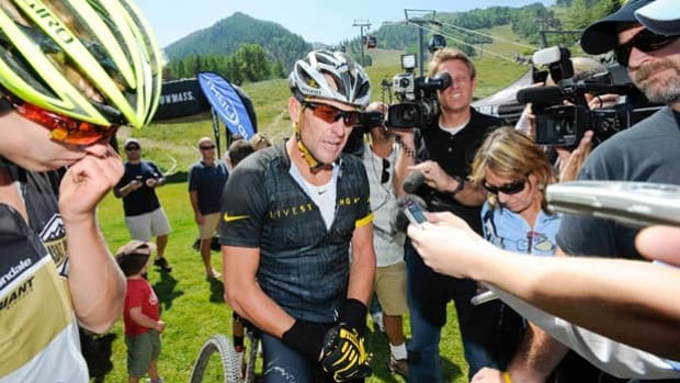 Lance Armstrong talks to reporters following the Power of Four Mountain Bike Race on Aug. 25.