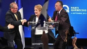 hi-852-marois-rushed-offstage-4col