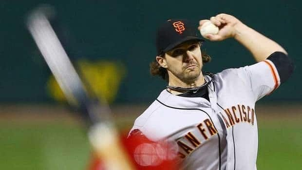 San Francisco Giants starting pitcher Barry Zito throws during the first inning of Game 5 of the NLCS against the St. Louis Cardinals on Friday in St. Louis.