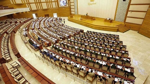 Burma's parliamentary Lower House opens without Aung San Suu Kyi and other opposition members, who were protesting the wording of the current oath of office.