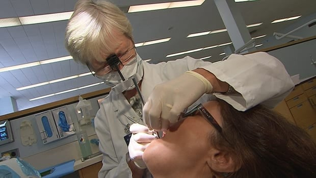 Theresa gets an examination by an expert at the University of Toronto before embarking on her visits to 20 different dentists.