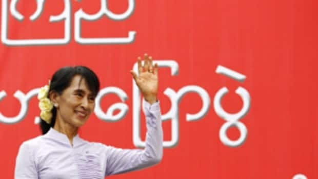 Burma opposition leader Aung San Suu Kyi waves toward supporters during the election campaign in March.